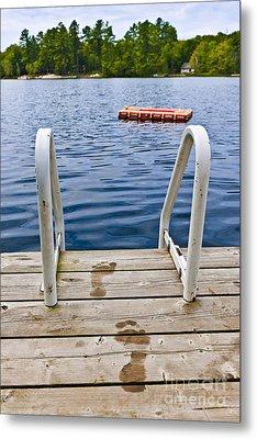 Footprints On Dock At Summer Lake Metal Print by Elena Elisseeva
