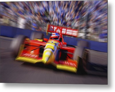 Formula Racing Car At Speed Metal Print by Don Hammond