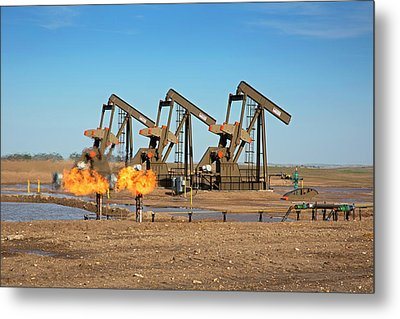 Gas Flares And Pumps At An Oil Field Metal Print by Jim West