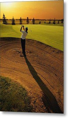 Golfer Taking A Swing From A Golf Bunker Metal Print by Darren Greenwood