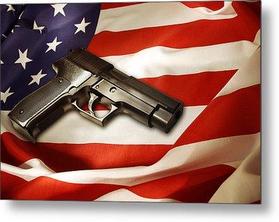 Gun On Flag Metal Print by Les Cunliffe