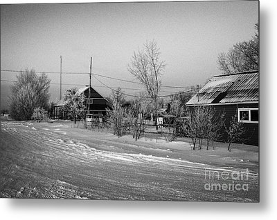 hoar frost covered street in small rural village of Forget Saskatchewan Canada Metal Print by Joe Fox