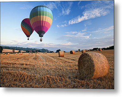 Hot Air Balloons Over Hay Bales Sunset Landscape Metal Print by Matthew Gibson