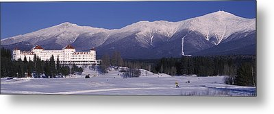 Hotel Near Snow Covered Mountains, Mt Metal Print by Panoramic Images