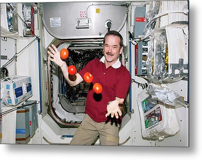 Iss Astronaut Juggling Metal Print by Nasa