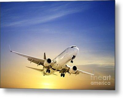 Jet Aeroplane Landing At Sunset Blue Yellow  Metal Print by Colin and Linda McKie