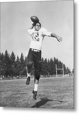 Joe Francis Throwing Football Metal Print by Underwood Archives