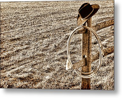 Lasso And Hat On Fence Post Metal Print by Olivier Le Queinec