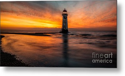 Lighthouse At Sunset Metal Print by Adrian Evans