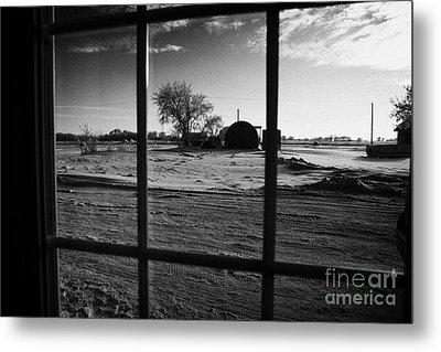 looking out through door window to snow covered scene in small rural village of Forget Saskatchewan  Metal Print by Joe Fox