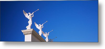Low Angle View Of Statues On A Wall Metal Print by Panoramic Images