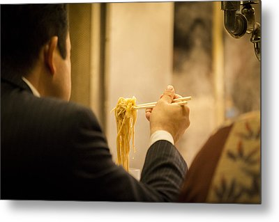 Man Eating Noodles In A Restaurant Metal Print by Ruben Vicente