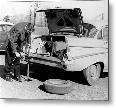 Man Jacking Up A Car Metal Print by Underwood Archives