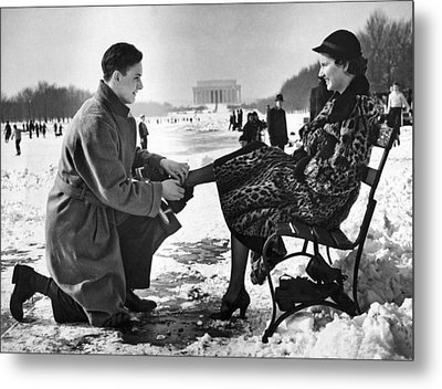 Man Lends A Helping Hand To Put On Skates Metal Print by Underwood Archives
