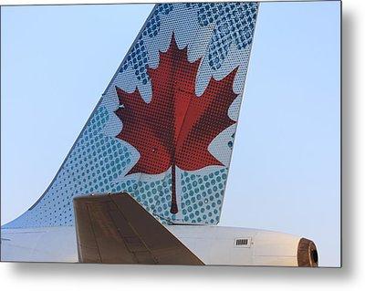 Maple Leaf Logo On Air Canada Airbus 319 Metal Print by Andrei Filippov