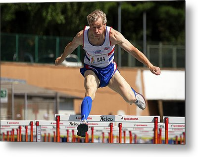 Masters British Athlete Clearing Hurdle Metal Print by Alex Rotas