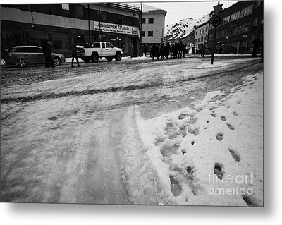 melting ice and snow on street surface holmen Honningsvag finnmark norway europe Metal Print by Joe Fox
