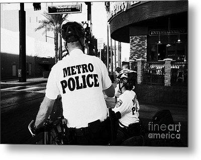 metro police bicycle cops in downtown Las Vegas Nevada USA Metal Print by Joe Fox
