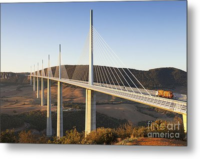 Millau Viaduct At Sunrise Midi Pyrenees France Metal Print by Colin and Linda McKie