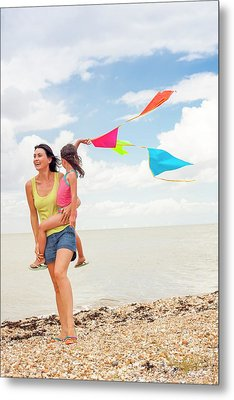 Mother And Daughter On Beach Metal Print by Ian Hooton