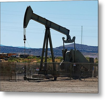 Oil Well  Pumper Metal Print by Dany Lison