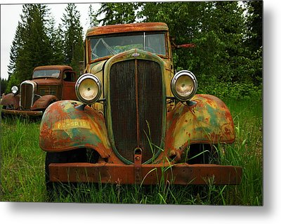 Old Cars Left To Decorate The Weeds Metal Print by Jeff Swan