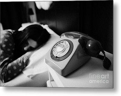 Old Fashioned Gpo Bt Phone On Bedside Table Of Early Twenties Woman In Bed In A Bedroom Metal Print by Joe Fox