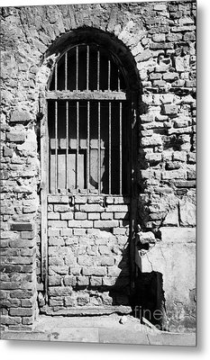 Old Wooden Framed Window With Weathered Steel Bars Door Replacement In Red Brick Building With Plaster Removed Krakow Metal Print by Joe Fox
