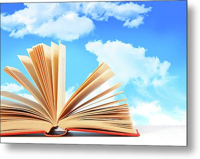 Open Book Against A Blue Sky Metal Print by Sandra Cunningham