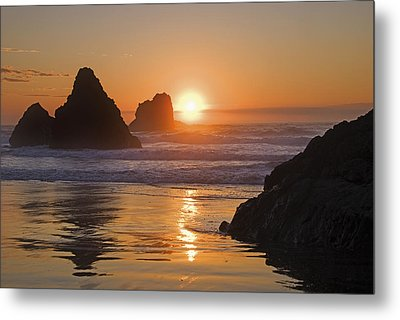 Orange Sunset Behind Offshore Rocks Metal Print by Philippe Widling