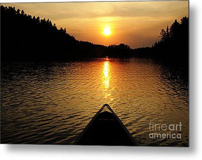 Paddling Off Into The Sunset Metal Print by Larry Ricker