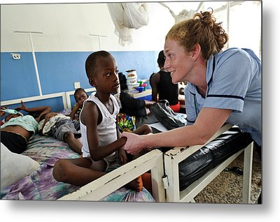 Paediatric Nursing In Sierra Leone Metal Print by Matthew Oldfield