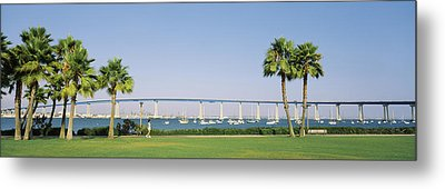 Palm Trees On The Coast With Bridge Metal Print by Panoramic Images