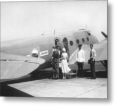 Passengers Boarding Airplane Metal Print by Underwood Archives