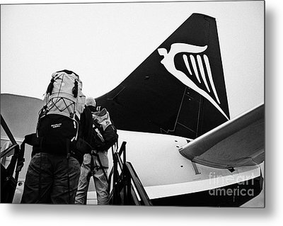 Passengers With Baggage Boarding Ryanair Flight At Dublin Airport Terminal 1 Ireland Metal Print by Joe Fox