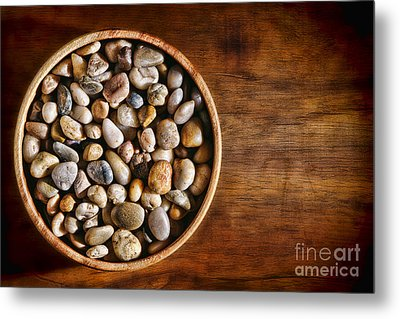 Pebbles In Wood Bowl Metal Print by Olivier Le Queinec