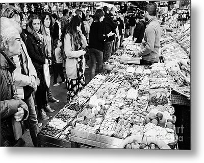 people buying chocolates on display inside the la boqueria market in Barcelona Catalonia Spain Metal Print by Joe Fox