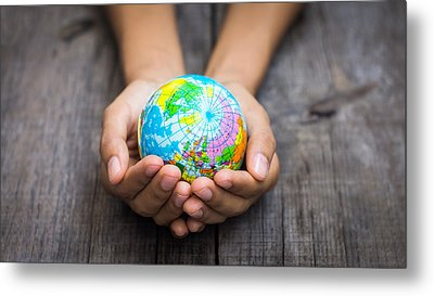 Person Holding A World Metal Print by Aged Pixel