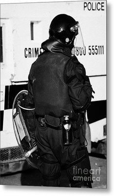 Psni Officer With Riot Gear On Crumlin Road At Ardoyne Shops Belfast 12th July Metal Print by Joe Fox