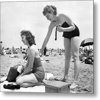 Putting On Sun Tan Lotion Metal Print by Underwood Archives
