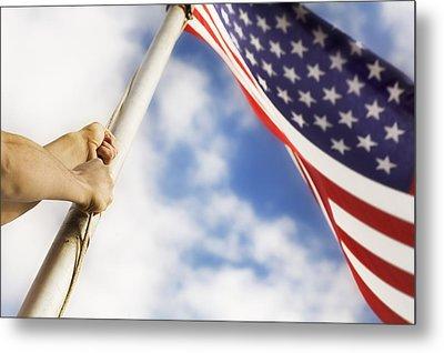 Raising An American Flag Metal Print by Chris and Kate Knorr