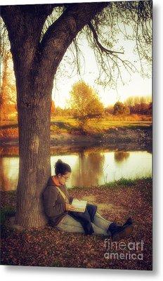 Reading Under The Tree Metal Print by Carlos Caetano