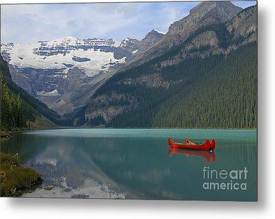 Red Canoes On Lake Louise Metal Print by Teresa Zieba