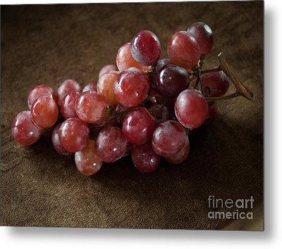 Red Grapes On Brown Cloth Metal Print by Nuttakit Sukjaroensuk