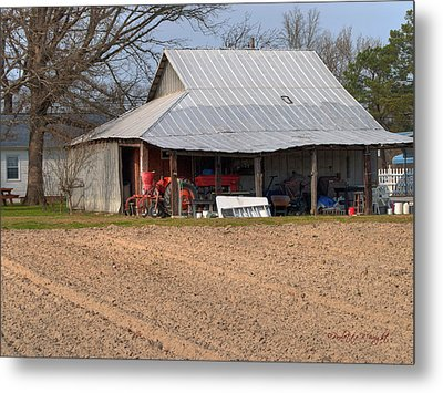 Red Tractor In A Tin Roofed Shed Metal Print by Paulette B Wright