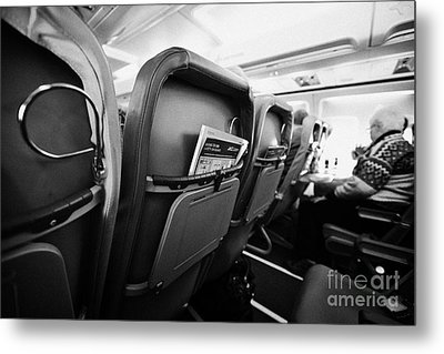 Safety Card And In Flight Magazine In Seat Pocket Interior Of Jet2 Aircraft Passenger Cabin In Fligh Metal Print by Joe Fox