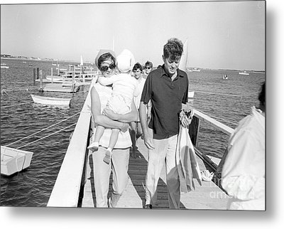 Senator John F. Kennedy And Jacqueline Kennedy At Hyannis Port Marina Metal Print by The Phillip Harrington Collection