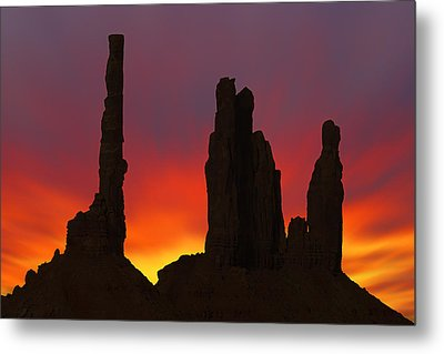 Silhouette Of Totem Pole After Sunset - Monument Valley Metal Print by Mike McGlothlen