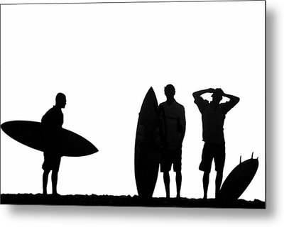 Silhouetted Surfers Metal Print by Sean Davey