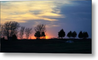 Silhouetts Of A Sunset Metal Print by Joan Bertucci